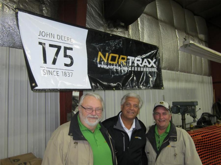 (L-R): Bob Vydrzal, used equipment manager, Nortrax Equipment; Mike Meyer, vice president of sales and marketing, Nortrax Equipment Co.; and Dean Adsit, used equipment sales welcome customers to the Mosinee, Wis. open house.