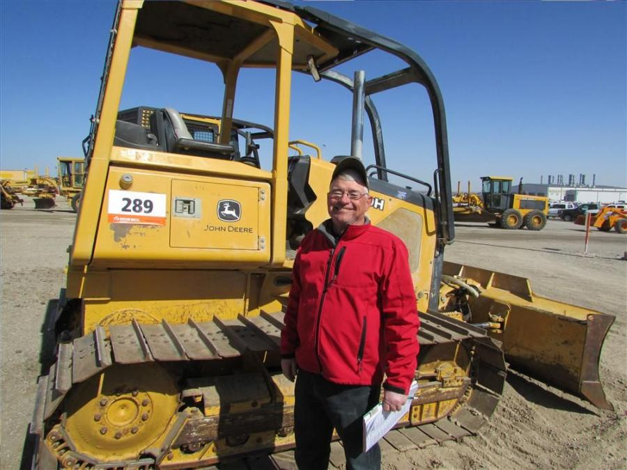 Lanny Williams, an independent contractor from Auburn, Neb., is very interested in this  John Deere 550H dozer.