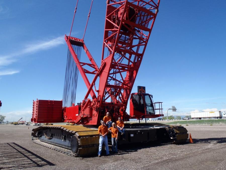 Ritchie Bros.' staff members pose with the 2006 Manitowoc 16000 440-ton (400 t) crawler crane that brought in a winning bid of $2.5 million during the Denver, Colo., auction on June 10 and 11.