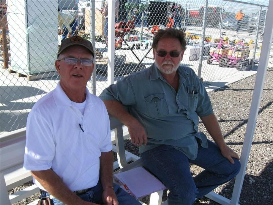 Barry Burgess (L) of Barry Burgess Equipment, Kemp, Okla., and Randy Henderson of High Hill Auto & Equipment, Atoka, Okla., take a break to discuss the auction prices.