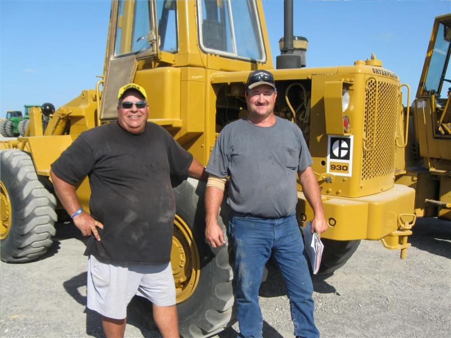 Dan Schreiber (L) and Charles Veitenheimer of C&G Veitenheimer Dairy, Windthorst, Texas, are interested in this Cat 930 loader to use in their cow pens.