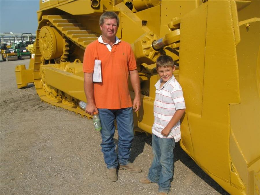 Jeff Sautter (L) and Jacob Merell of Jeff Sautter Enterprises, Mathis, Texas, take a photo op with this Caterpillar D9L.