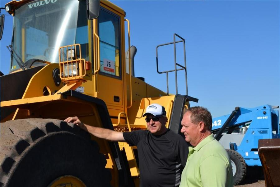 Bob Grandberg (L) of Grandberg Construction and Tony Gray of TF Gray Contracting, LTD check out a Volvo L220E at the recent Ritchie Bros. auction in Phoenix, Ariz. Both companies are located in Kamloops, British Columbia.
