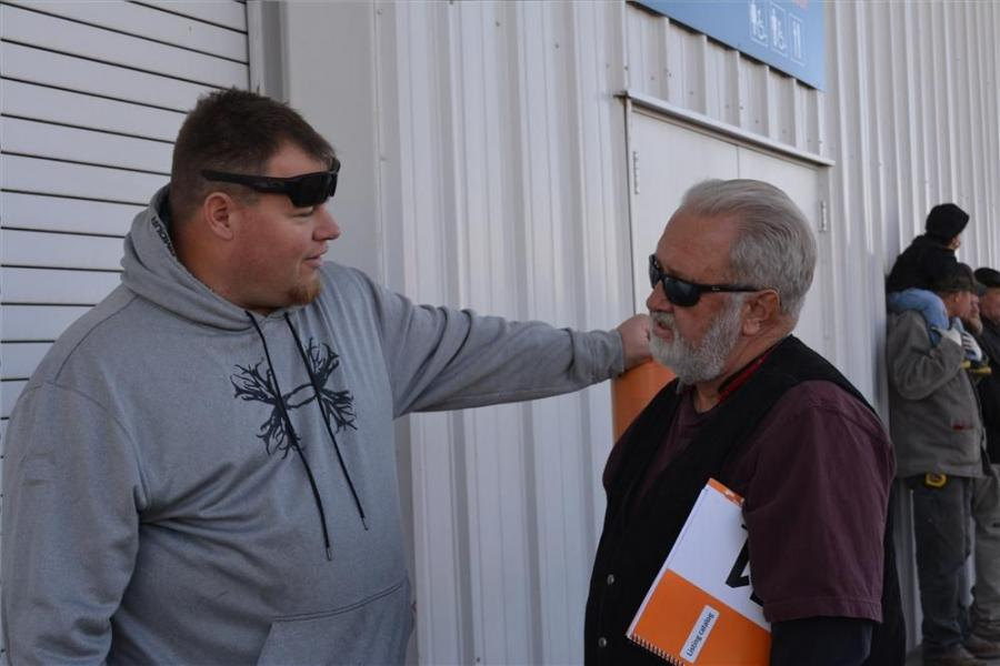 Joe Rexin (L) of T-Rex Equipment, Long Beach, Calif., chats with Harry Hansen of U-Pick It, an auto and scrap metal recycling facility in Prescott Valley, Ariz. Both made purchases at the Nov. 18 auction.