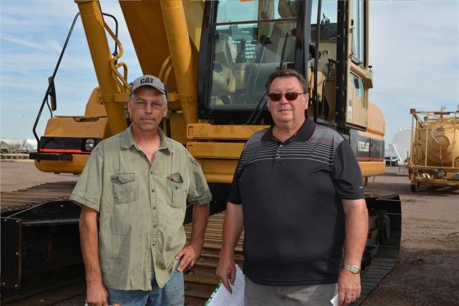 Dwight Nelson (L) and Leroy Anderson of Anderson Contracting Inc., in Solway, Minn., were on hand to bid on excavators. This Outlaw MS400 piqued their interest.