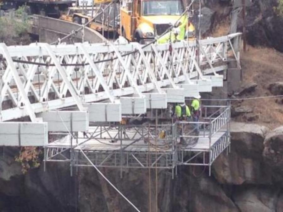 Spider, a division of SafeWorks LLC, provided the suspended scaffolding solution for maintenance on a wooden suspension bridge that spans the south fork of the American River in Placerville, Calif.