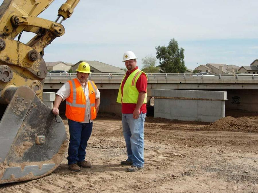 Haydon Building Corp. recently used Topcon Positioning Systems' X63 excavator control system and a cellular network operated by Branco Machinery to dig pier footing excavations for a bridge-widening project near Phoenix. Jeff Fields of Haydon (L) an