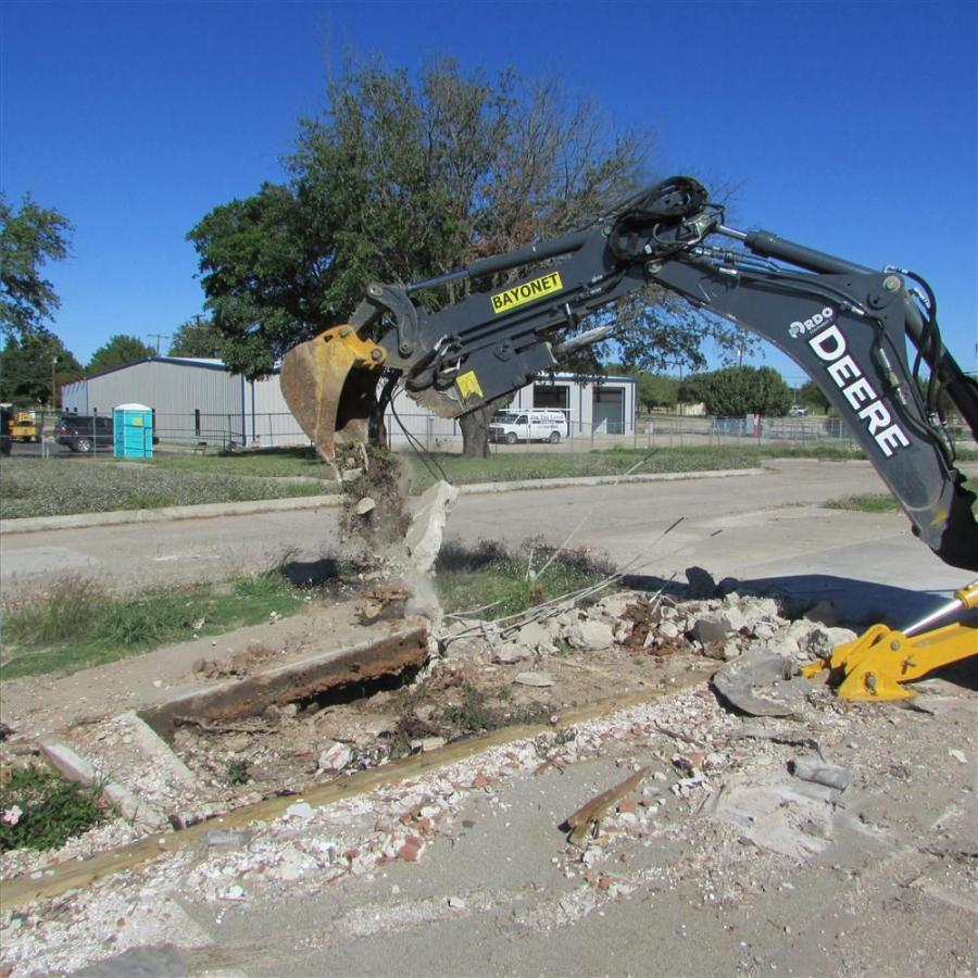 Bayonet Breaker bucket removing the hammered sidewalk at the West Rest Haven retirement home.