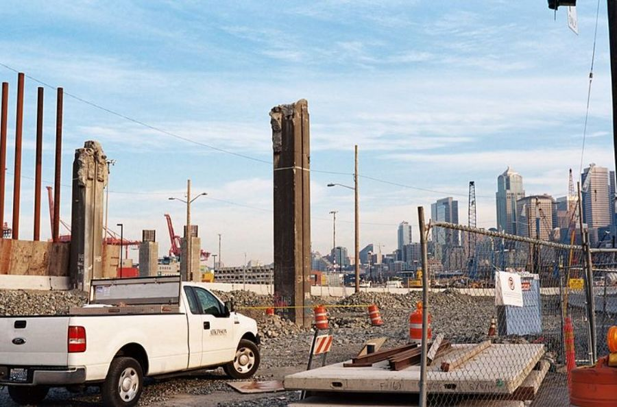 Photo by Dennis Bratland.  Construction area around Alaskan Way Viaduct replacement tunnel. Two columns from demolished portion of Viaduct. Near S. Royal Brougham Way and E. Frontage Road S., Seattle, Washington.