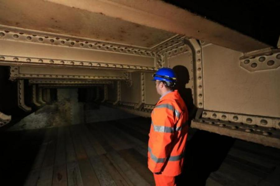 Image courtesy of This is Local London.  Project manager Greg Thornett looks at the remains of Southwark Park station, hidden in the catacombs under the railway in Bermondsey.