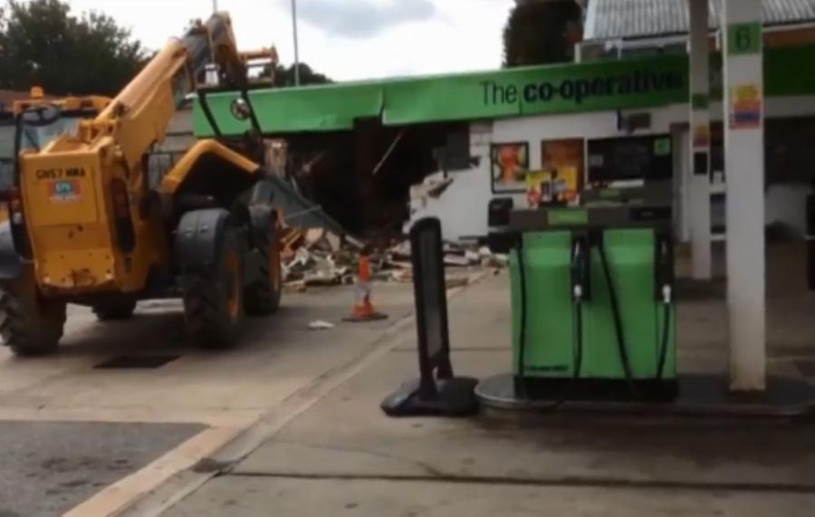 The heavy machinery was used to lift the cash point away from the wall and lowered into a getaway vehicle which had its roof cut off to make space for the loot.