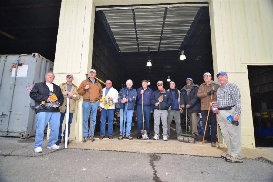 A group of men know as the Kingsport Regulars pose outside there storage building in Kingsport, Tenn, March 20, 2013. The get together and help build houses for low-income families L to R: Jim Boushley, Doyle Alley, John Peters, Geoff Dougal, Charles Barr