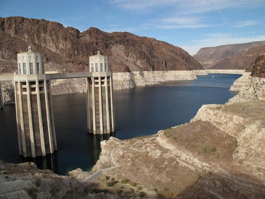 Concrete pouring began March 1 and was expected to continue for several more days, until a funnel-like structure about 100 ft. (30.5 m) tall and weighing 1,200 tons (1,088 t) is secured some 350 ft. (107 m) beneath the surface of the vast Colorado River r