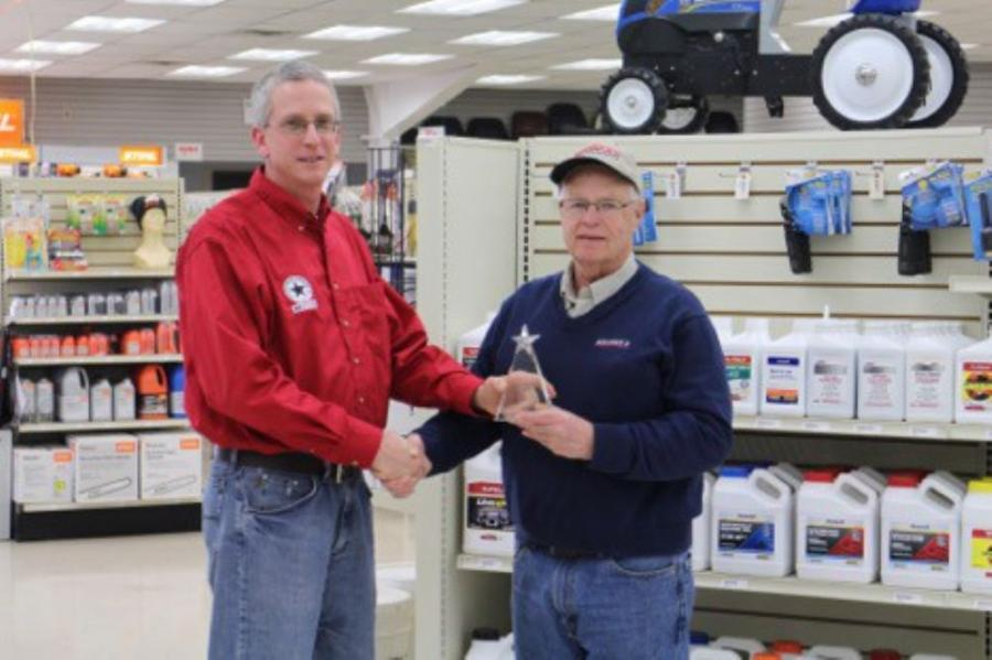 Ross Johnson (L), Meyer Manufacturing's Regional Sales Manager presents the award to Bob Messick.
