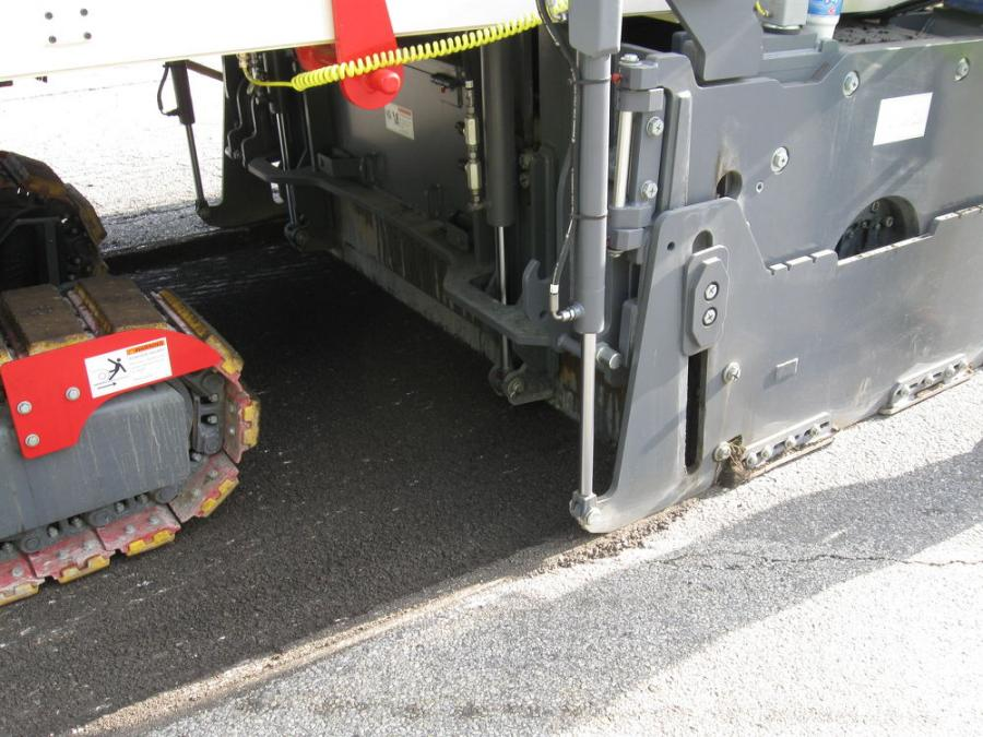 The Wirtgen W210i is shown here surface milling at a uniform 2.5 in. (6.4 cm) deep waring course.