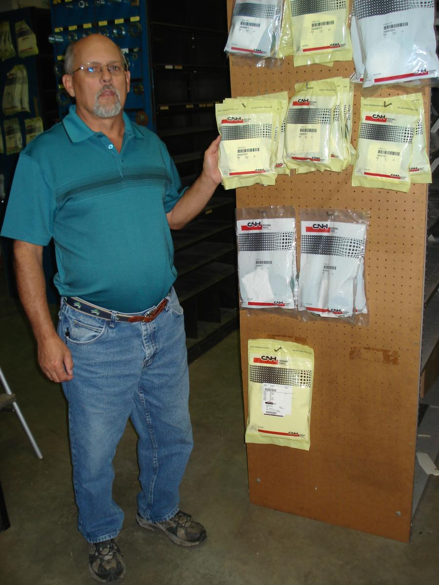 Lawrence Equipment has a fully stocked parts department. Delaine Babb fills another parts order from a local contractor.