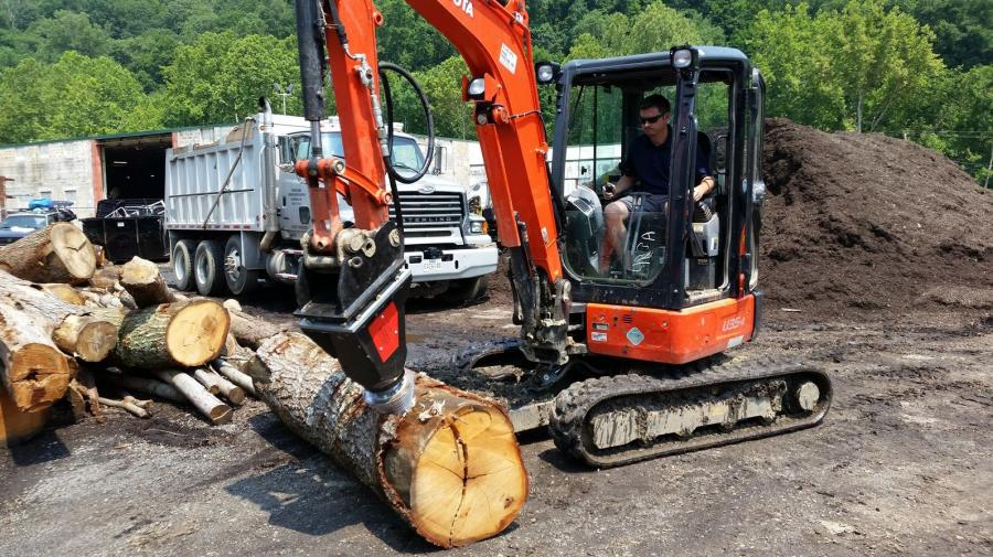 Maryland Landscape Supply owner Ethan Langrill uses the Black Splitter S2X 800 to split a log at the firm's Ellicott City location.