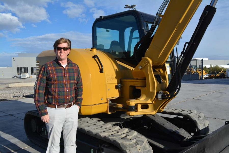 Zach Summers, pictured with a Cat 308 excavator, was on hand for the auction. Summers is the Caterpillar BCP industry rep for the northwest.