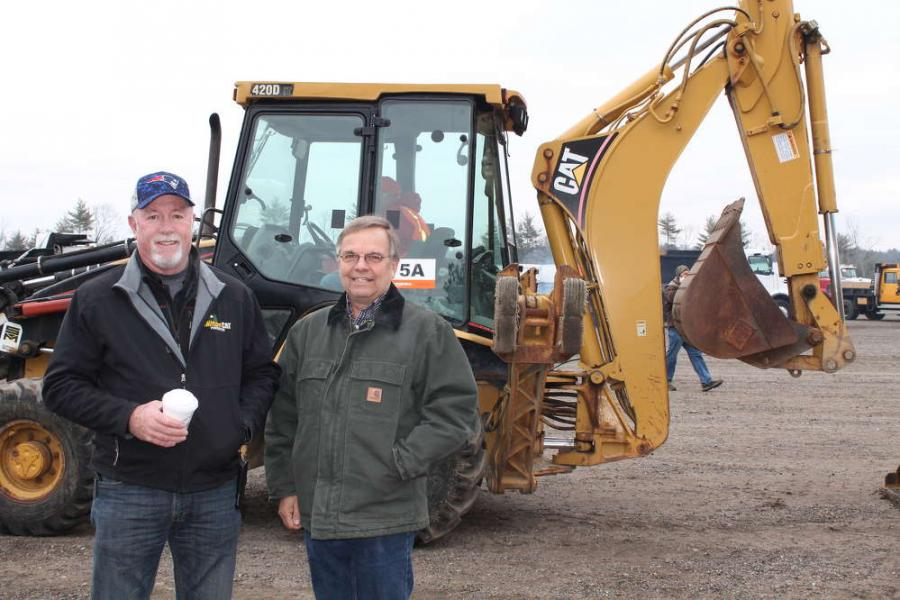 Mike Sherman (L) and Bill Inman, both of Milton CAT, check out the sale.