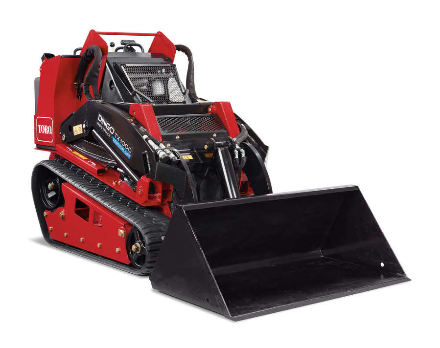 The Toro Dingo TX 1000 has a rated operating capacity exceeding 1,000 lbs. When the loader arms are fully extended, the hinge pin measures 81 in. (205.7 cm) from the ground to allow the TX 1000 to easily reach over the side of dumpsters and one-ton trucks