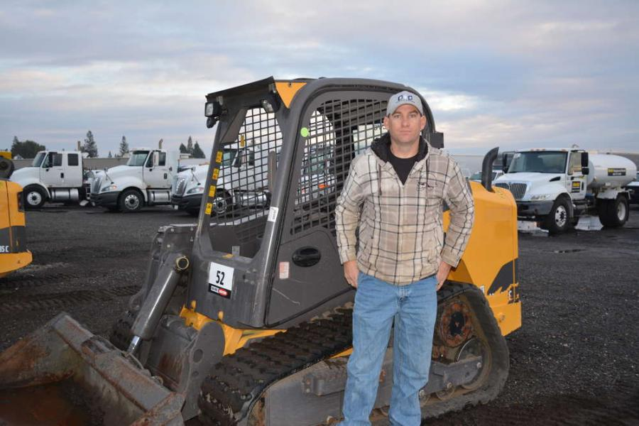 RNR Construction's Kyle Holmes was on hand to bid on one or more skid steer loaders. Here, he is pictured with a Volvo MCT 135C. RNR is a heavy civil construction company based in Sacramento.