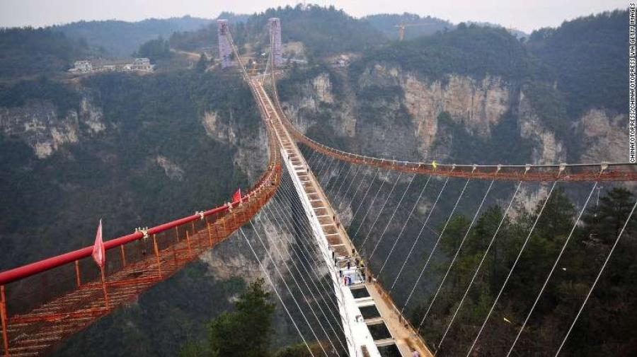 Set against dramatic landscapes in Zhangjiajie National Forest Park, the bridge is 430 meters long, six meters wide and hovers over a 300-meter vertical drop.