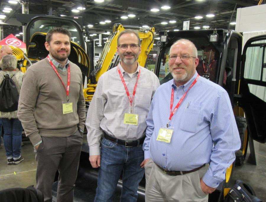 (L-R): Kevin Ray, Michael Burns and Steve Huml, all of Burns JCB, discuss the lineup of JCB machines.