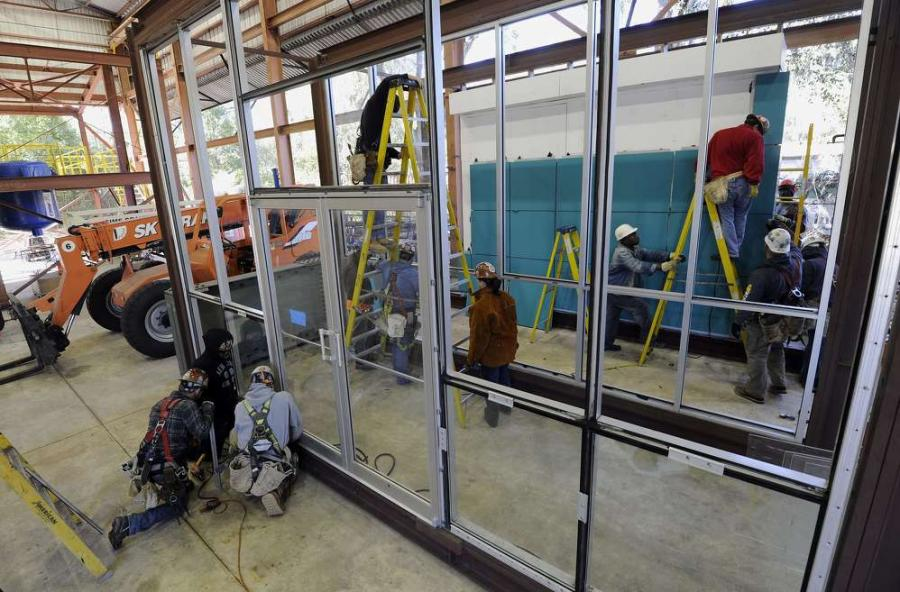 The Bureau of Labor Statistics puts the average wage for construction occupations in Florida at $37,000, using 2014 figures. (Chris Urso/Tampa Tribune photo)