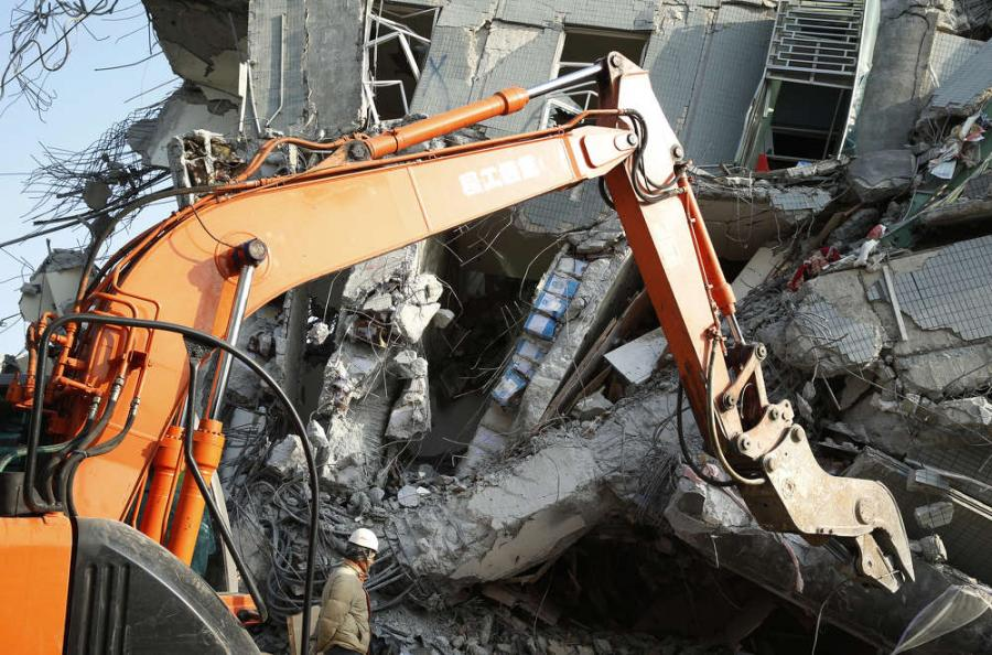 AP Photo - Three Taiwanese construction company executives have been detained on charges of professional negligence resulting in death following the collapse of an apartment building in an earthquake, killing dozens.