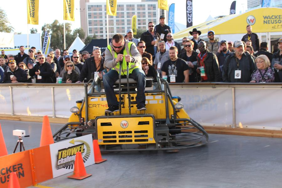 Hundreds of people watched Kevin Suchy cross the finish line as he wins the 2016 Wacker Neuson Trowel Challenge at the World of Concrete, February 4, 2016 in Las Vegas. Suchy's ride-on trowel operating skills out-paced over 150 other competitors in the an