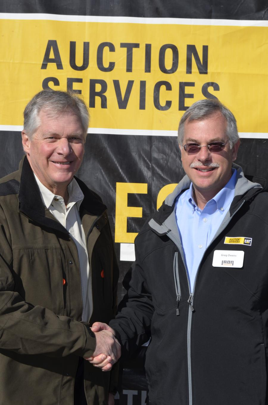 Caterpillar Chief Executive Officer Doug Oberhelman (L) and IronPlanet/Cat Auction Services  Chairman and CEO Greg Owens.