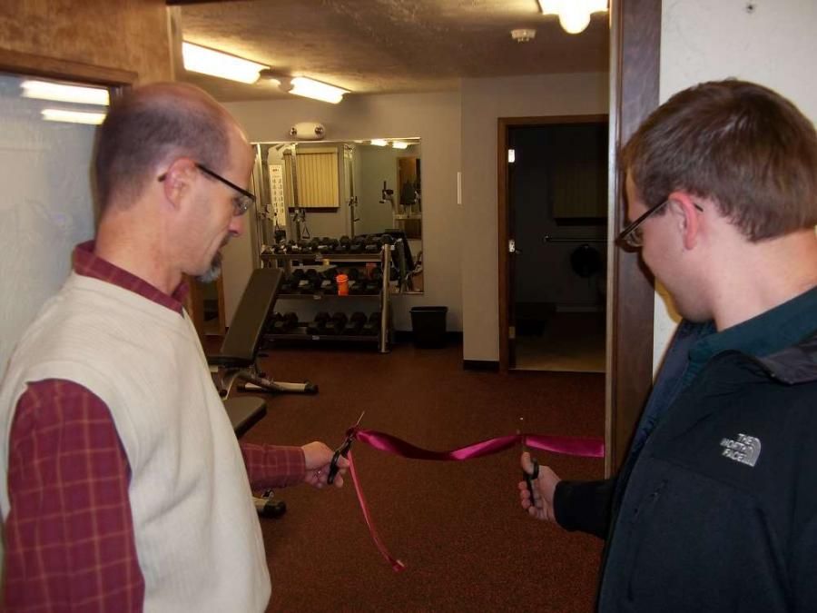 Keith Brubacher, president, and Kent Gable, Wellness Committee representative, cut the ribbon to the entranceway of the Brubacher Employee Fitness Center.