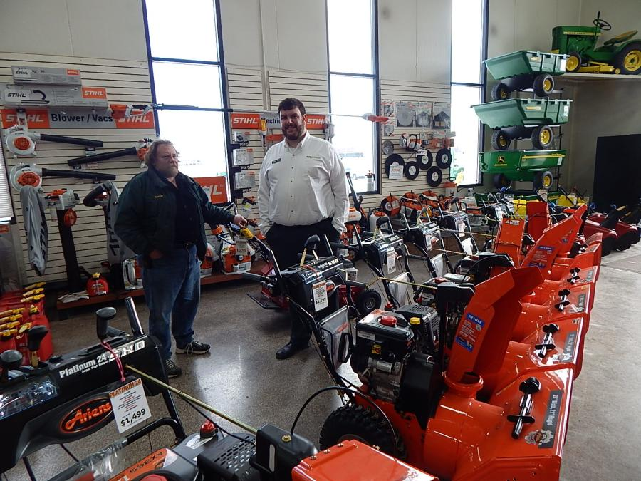 Randy Schoer (L) of RSM Lawn & Snow, East Bethel, Minn., and Jonathan Nordrum, Minnesota Equipment Inc., commercial sales manager, go over the new Ariens snowblowers.