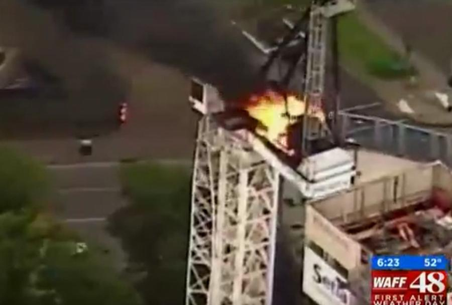ABC News Affiliate KTRK is reporting that a crane burst into flames and collapsed ten stories onto a building under construction in Melbourne, Australia.