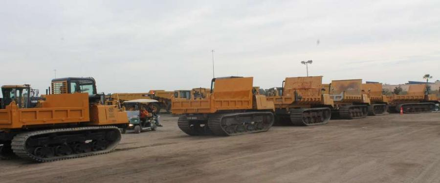 The inventory of track dump trucks (crawlers) are lined up and ready to be auctioned off.