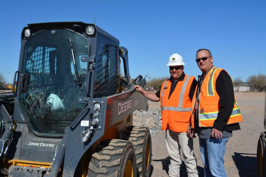 Ryan Ruhl (L), John Deere product consultant, gives some insight on the Deere 320E skid steer to John Keefe, sales professional of RDO Equipment Co.'s Rochester, Minn., branch.