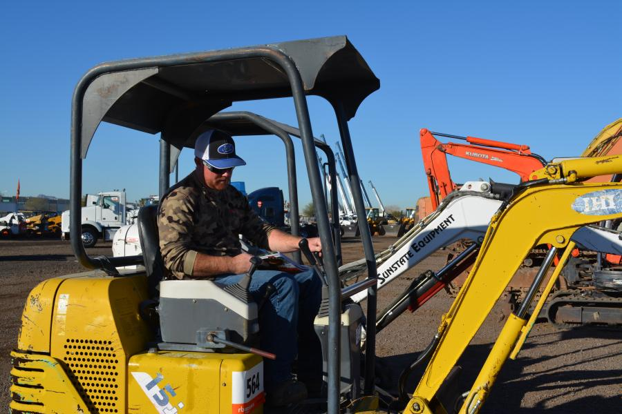 Joe Mulcaire of JMC Contracting, Cottonwood, Ariz., was in the market for a mini-excavator and he had many to choose from in Phoenix. Here, he checks out the IHI 15J.