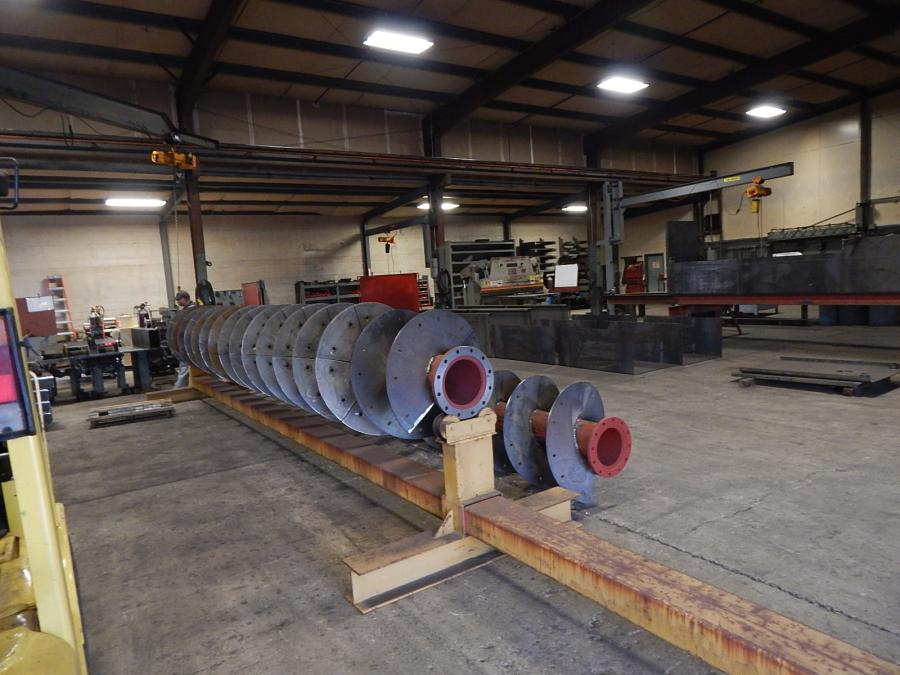 RD Olson manufacturers many of the parts and components used in its equipment, like these large sand screws.