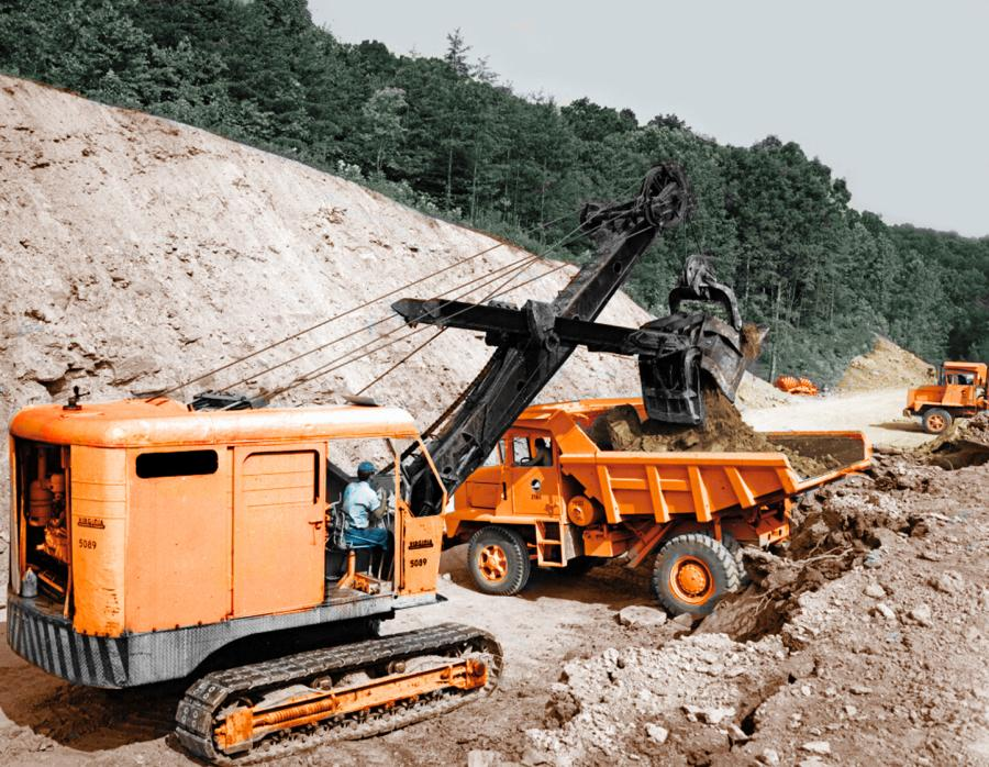 In 1969 the Virginia Department of Highways used a P&H 655B shovel to load a fleet of Mack M-15X off- highway end dump trucks with earth and rock.