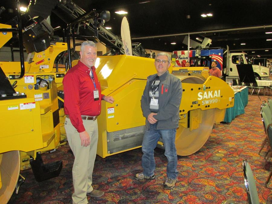 Bob Young (L) of Power Motive in Denver, Colo., discusses all the possibilities of the Sakai SW 990-1 with Oleg Gorlach, project inspector of LS/GALLEGOS at the Denver International Airport.
