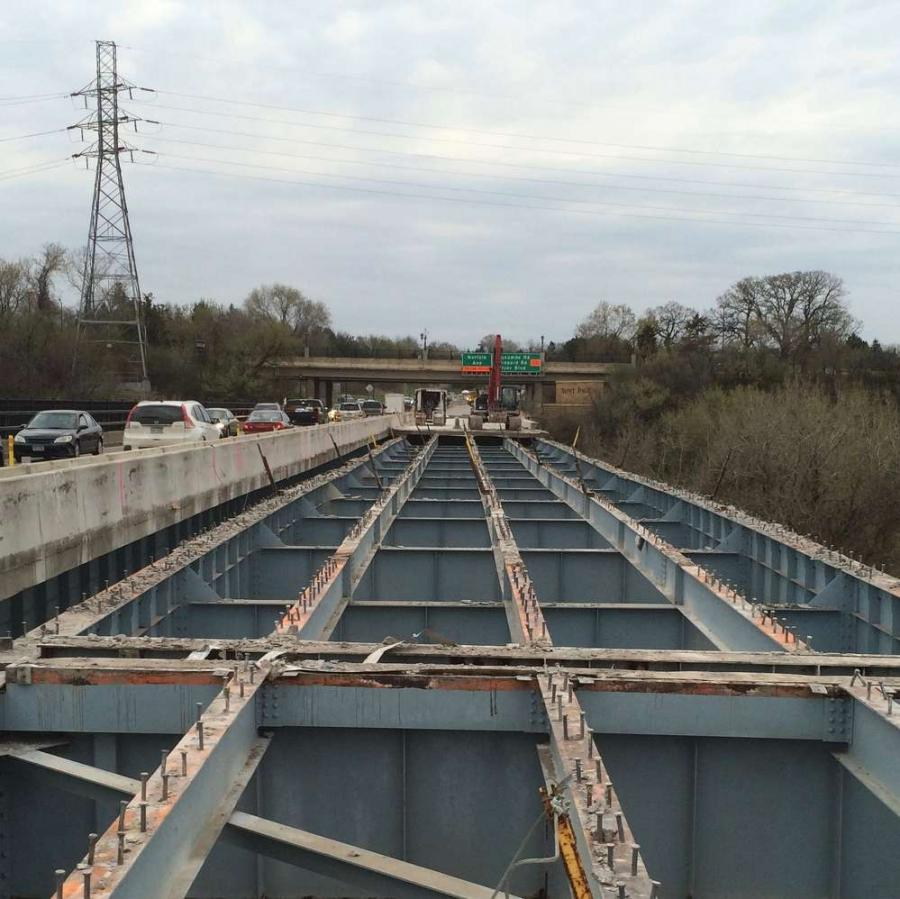 The Minnesota Department of Transportation (MnDOT) is spending $13.8 million to rebuild the deck of the Highway 5 bridge/West 7th Street Bridge, an east-west, 1,999-ft. (609.3 m) long span (two lanes in each direction) across the Mississippi River.