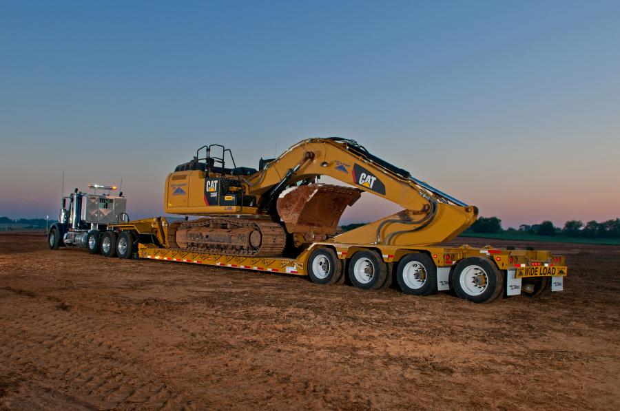 The 55-ton (50 t) tri-axle trailer featuring a 26-ft. (7.9 m) long by 9-ft. (2.7 m) wide deck provided maximum stability to haul wide machines, such as articulated dump trucks, large excavators and cranes, that operators used to extract Corvettes from the