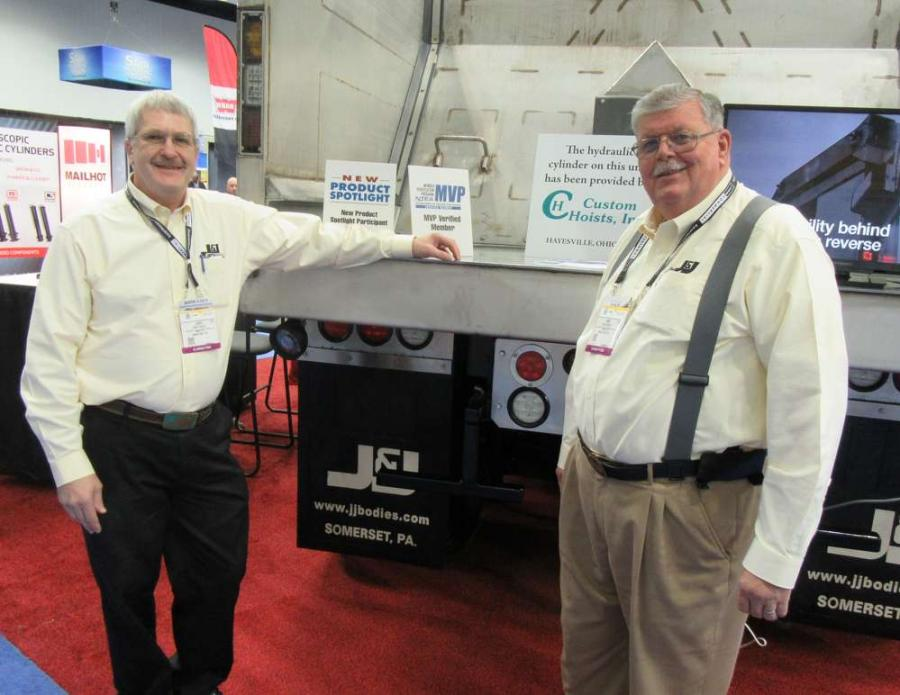Larry Faidley (L) and Ron Wright, both of J&J Truck Bodies & Trailers, enjoy speaking with attendees about the company's horizontal ejector body.
