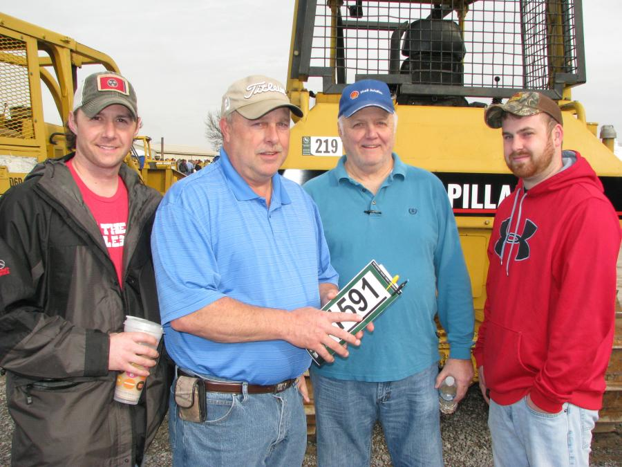 (L-R): Billy Reese, independent contractor based in Lebanon, Tenn.; Paul Rawdon, R & B Enterprises, Hohenwald, Tenn.; War Reese of Hohenwald, Tenn.; and Dustin Rawdon, also of R & B Enterprises, shop the selection of the dozers at the sale.
