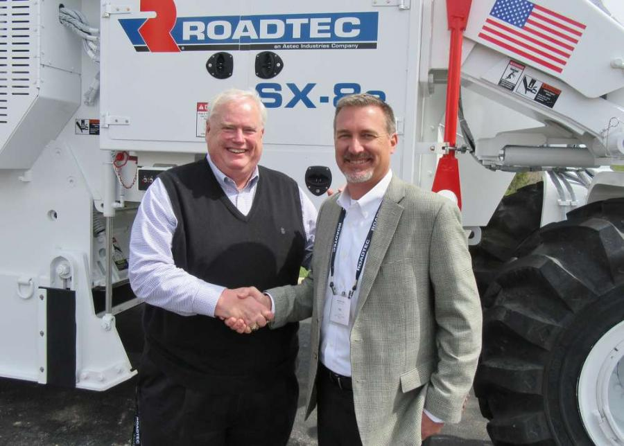 Chris Connolly (L), Roadtec national sales manager, east, congratulates Tim Albright, Columbus Equipment Company vice president, sales and marketing.
