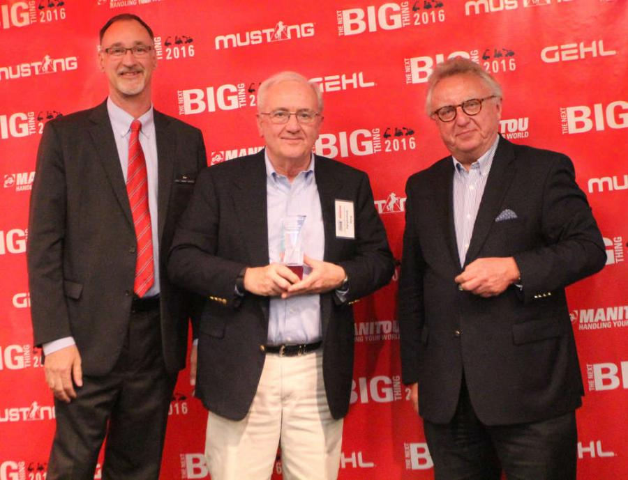 Dan Miller, President & CEO of Manitou Americas, and François Piffard, Executive VP of  Sales and Marketing for Manitou Group, present the 2015 Manitou Top Dealer Award to  Pete Smeretsky of Transport Equipment Sales.