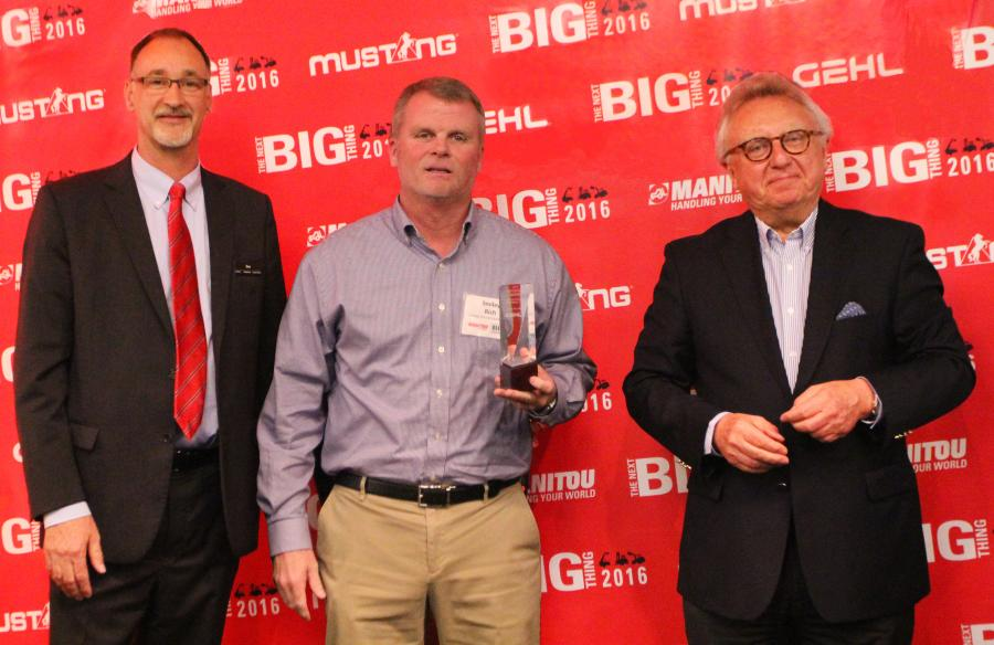 Dan Miller, President & CEO of Manitou Americas, and François Piffard, Executive VP of  Sales and Marketing for Manitou Group, present the 2015 Gehl Top Dealer Award to  Smiley Rich of Custom Truck & Equipment.