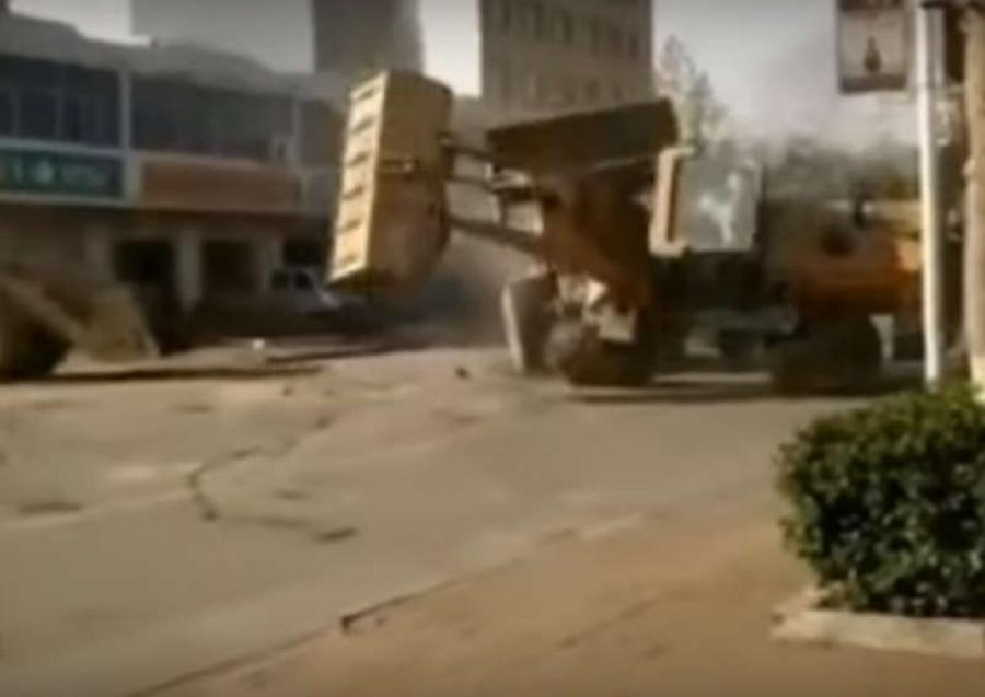 Police in northern China say an argument between construction workers escalated into a demolition derby-style clash of heavy machinery that left at least two bulldozers flipped over in a street.