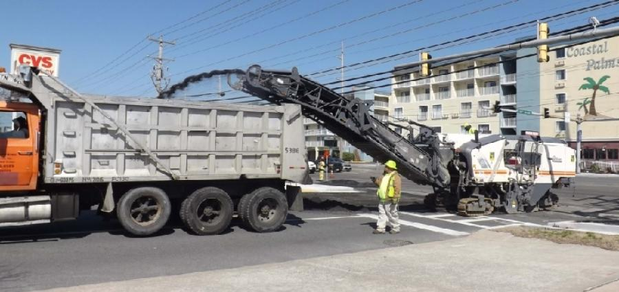 Crews grind old pavement during the Coastal Highway (MD 528) resurfacing project.