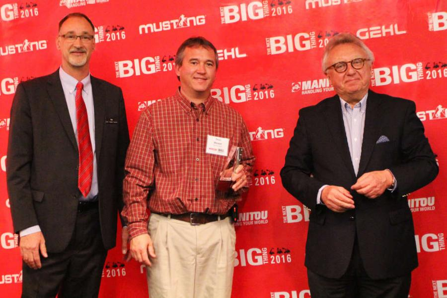 Dan Miller, President & CEO of Manitou Americas, and François Piffard, Executive VP of Sales and Marketing for Manitou Group, present the 2015 Gehl Top Dealer Award to Dean Weaver of Binkley and Hurst, LP.